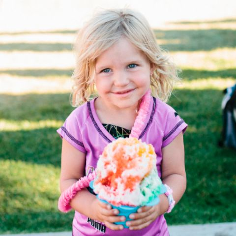 Little Girl Smiling with a Snow Cone | Daybreak Utah, Homes for Sale in South Jordan