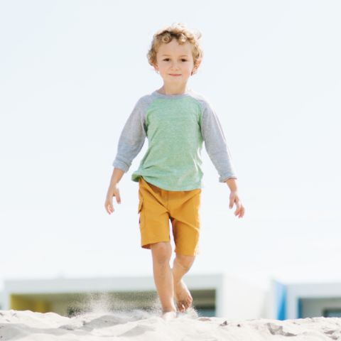 Boy Walking on Sand in Daybreak's The Island | Daybreak Utah, South Jordan