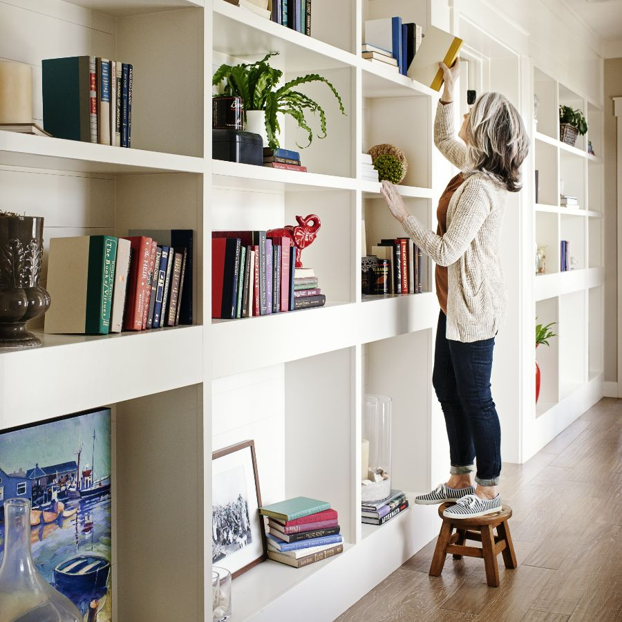 Woman Decorating Bookshelf | Homes for Sale at Daybreak