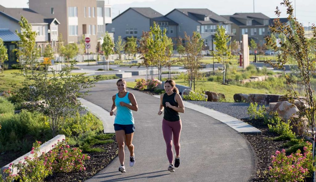 Two women running in Daybreak for their daily exercise.
