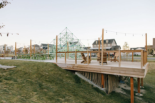 Firefly Park with a play structure, picnic tables & tie pier-like decks at Daybreak Utah
