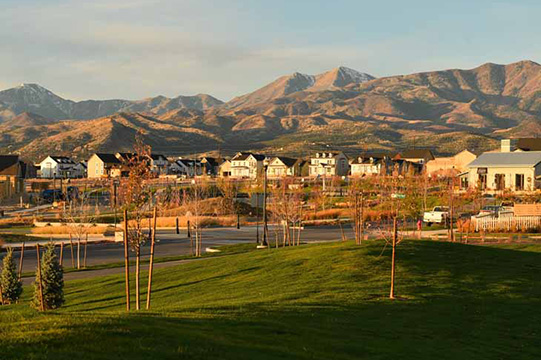 Highland Park, aka South Jordan City Park with picnic tables, pickleball courts, a playground and soccer fields at Daybreak Utah