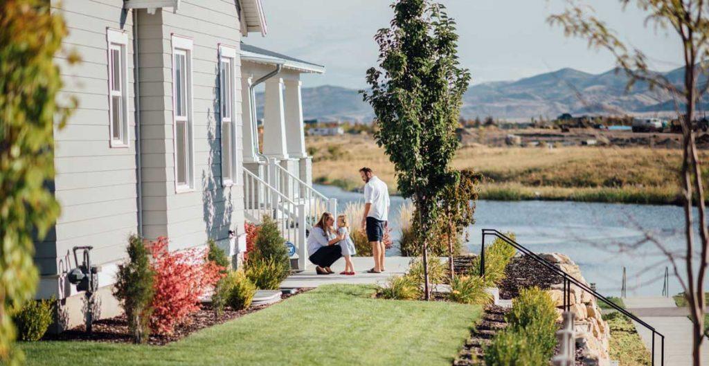Family in front of their new Daybreak home, Oquirrh Lake, Hot housing market   Daybreak Utah
