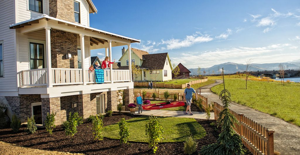 Family carrying a canoe out to Oquirrh Lake in Daybreak. Enjoying Daybreak amenities paid for by HOA assessments. 5 Things to Know About Homeowner Associations in Utah | Daybreak Utah