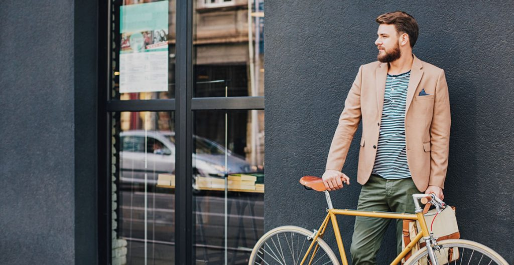 Businessman with a bike on the street| Job Growth in Utah